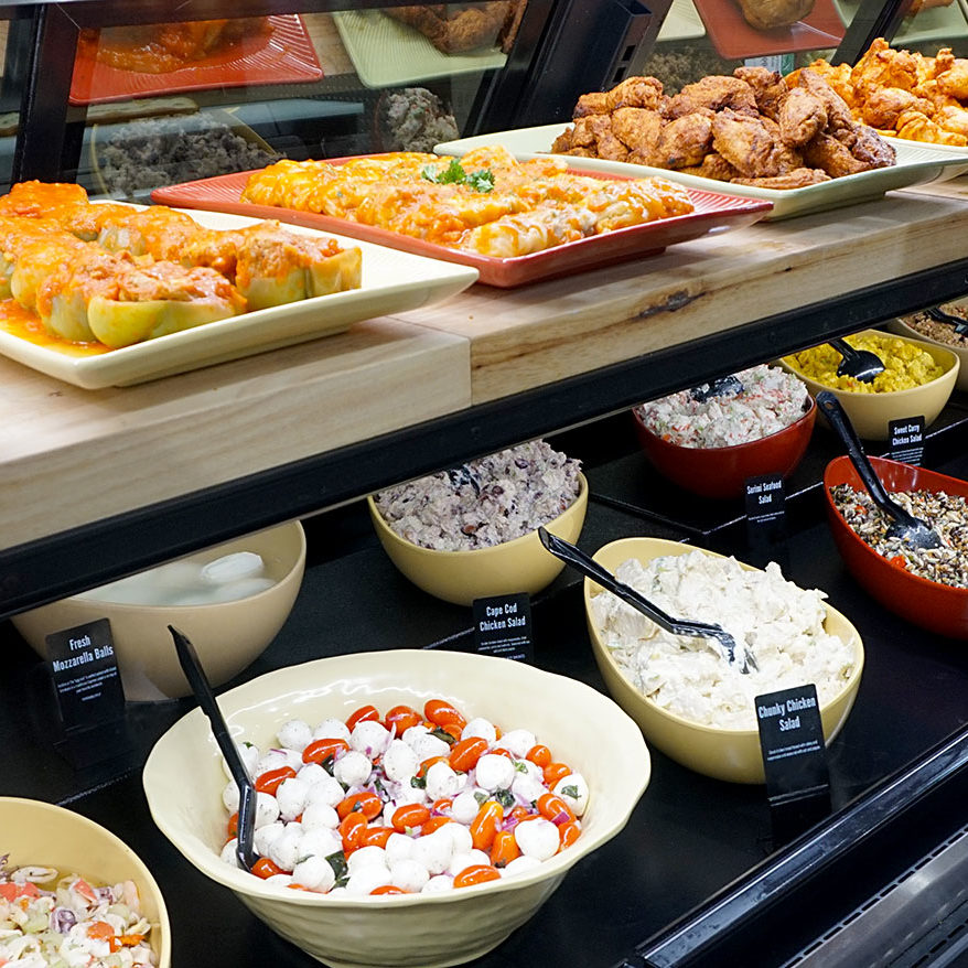Caraluzzi's Premium Delicatessen - case display with chef prepared meals