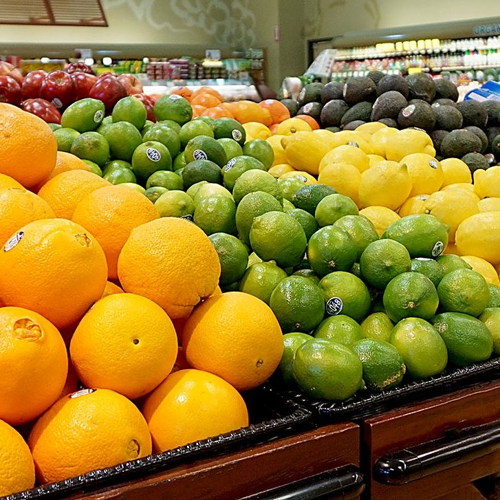 Caraluzzi's Newtown Produce Department Farm Fresh Produce - Tomatoes on the Vine, Oranges, Limes, Lemons, Avocados in produce department